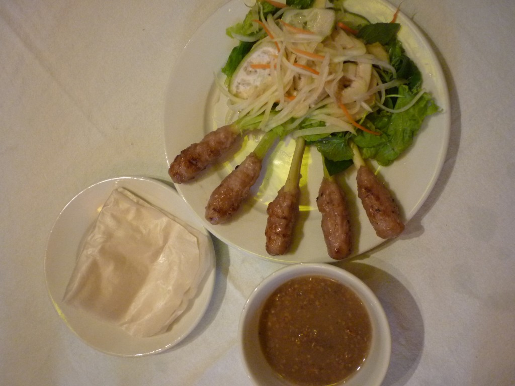 Vietnamese Nem lui pork on lemongrass sticks