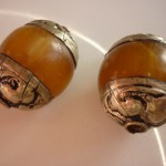 Large amber and stainless steel beads