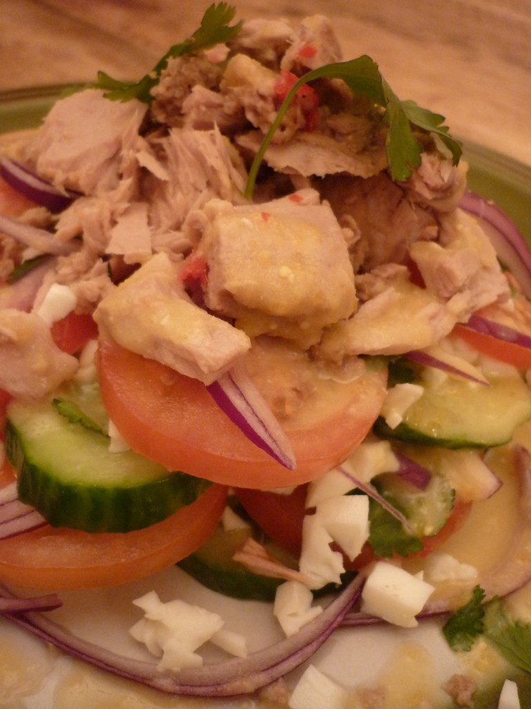 Laos salad stacked salad tuna and citrus sauce