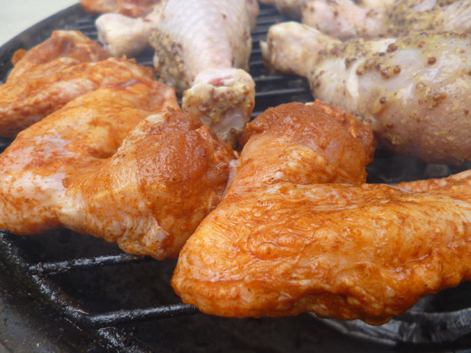 hot wings smoking on the BBQ